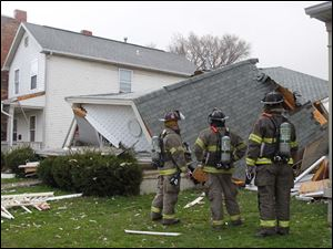 Toledo police and fire departments on the scene of a house in the 1400 block of Huron Street, that collapsed.
