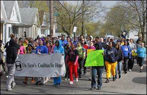 Toledo youth and adults alike, invited by the Toledo Youth Services Commission and the Coalition for Hope, march against violence down Elm Street near Noble.