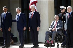 President Barack Obama stands with, from second from left, former Presidents George W. Bush, Bill Clinton, George H.W. Bush, and Jimmy Carter at the dedication today of the George W. Bush presidential library on the campus of Southern Methodist University in Dallas.
