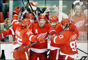 From left to right, Red Wings Niklas Kronwall, Jakub Kindl, Pavel Datsyuk, Henrik Zetterberg, and Johan Franzen celebrate Datsyuk's goal during the second period.