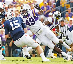LSU defensive end Barkevious Mingo will play outside linebacker for the Browns, who are switching from a 4-3 alignment to an aggressive, 3-4 multifront scheme under new coordinator Ray Horton.