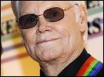 George Jones arrives for the Kennedy Center Honors at the Kennedy Center in Washington The country music mega-star passed away today at 81.