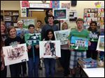Perrysburg High School students show off their historic home paintings.