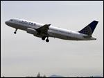 In this April 23, 2013 photo, a United Airlines jet departs in view of the air traffic control tower at Seattle-Tacoma International Airport in Seattle. With flight delays mounting, the Senate approved hurry-up legislation Thursday night to end air traffic controller furloughs.