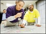 Gang members 'Kid,' left, and 'Chaos,' who are incarcerated at the Lucas County Correctional Treatment Facility on Jefferson Avenue, help create a Toledo gang-territories map for The Blade. The pair would only give their street names.