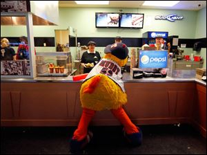 Muddy the Mud Hen visits with concession workers as the Toledo Mud Hens play the Columbus Clippers at Fifth Third Field.