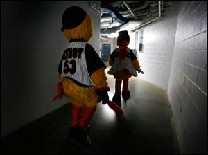 Muddy and Mudonna walk through the lower level of Fifth Third Field as the Toledo Mud Hens play the Columbus Clippers.