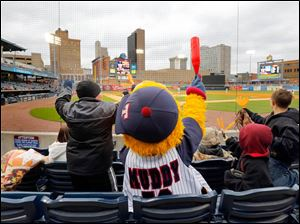 Muddy the Mud Hen gets the young fans cheering as the Toledo Mud Hens play the Columbus Clippers at Fifth Third Field.