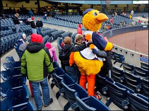 Muddy the Mud Hen is surrounded by fans as the Toledo Mud Hens play the Columbus Clippers at Fifth Third Field.