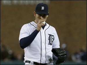 Detroit Tigers pitcher Anibal Sanchez kisses the ball after striking out Atlanta Braves' Reed Johnson in the eighth inning of a baseball game in Detroit, Friday April 26, 2013.  Sanchez struck out 17 in eight innings.