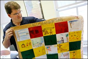 Principal Scott Best shows a quilt made by kindergartners at Fort Meigs Elementary. The quilt, which was themed for Fort Meigs, was one of the students' projects on display at the fort's museum.