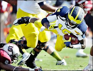 Michigan's Denard Robinson was selected by Jacksonville in the fifth round on Saturday, the first Wolverine picked this year.