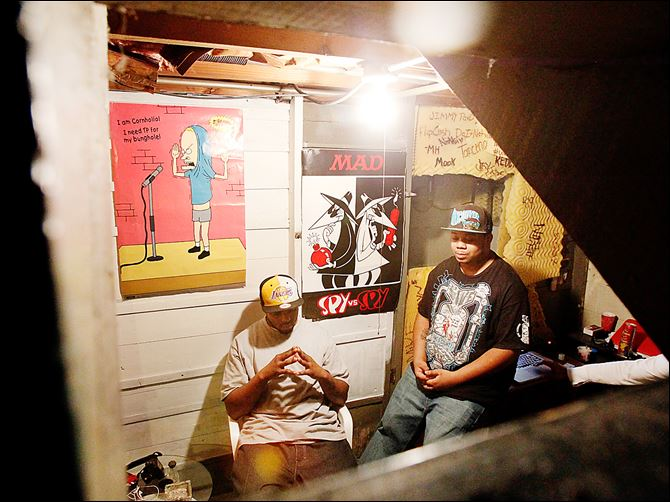 Toledo gangs Aaron Belton Aaron Belton, left, and his brother Christopher Belton sit in their basement recording studio where Christopher composes music for his group Flip Cash.