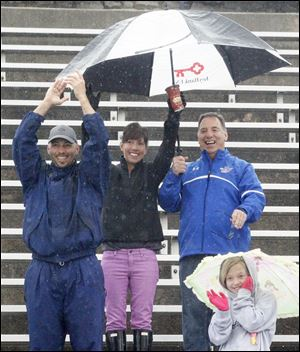 Rainy, cool weather didn't keep fans from turning out to cheer on the runners  at the University of Toledo.