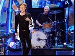 "Mick Jagger, left, and Charlie Watts of the Rolling Stones, shown performing in December in Newark, N.J., played a surprise warm-up date in a small club in Los Angeles Saturday before kicking off their ""50 and Counting tour later this week."