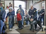 Woodville police Officer Steve Gilkerson introduces his new police dog, Raider, to 70 residents at the Woodville Public Library. Raider, a 14-month-old Dutch shepherd, came from Belgium and is still being trained. The dog is expected to be ready for duty by the third week of May.