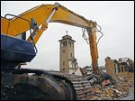 The demolition of St. Ignatius Catholic Church in Oregon, which dated to 1927, is near completion. The parish plans to open its new 11,931-square-foot church by March. The project cost is $3 million.