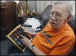 Korean War vet Bill Williams, with medals he received for wartime service, also recalls growing up during World War II, when he lived near the POW camp at the Rossford Ordnance Depot.