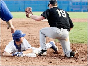 Anthony Wayne's Tyler Deye safely steals third base past the tag of Perrysburg's Mark Delas.