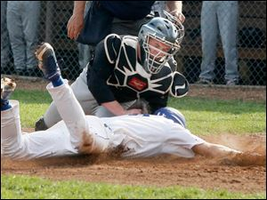 Perrysburg's Kyle Durham tags out Anthony Wayne's Tommy Eichenlaub at home plate.