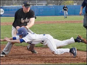 Perrysburg's Mark Delas tags out Anthony Wayne's  Vince Schneider.