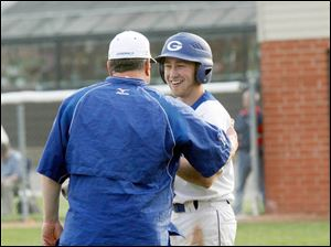 Anthony Wayne baseball coach Mark Nell gives words of inspiration to batter Tyler Deye before hitting in the seventh inning against Perrysburg.