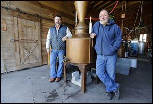 Darrin Critchet, left, registered agent and investor, with permit owner Ernest Scarano at Ernest Scarano Distillery in Fremont.