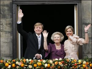 Dutch King Willem-Alexander, Queen Maxima, right, and Princess Beatrix appear on the balcony of the Royal Palace in Amsterdam, The Netherlands today. About a million people are expected to descend on the Dutch capital for a huge street party to celebrate the first new Dutch monarch in 33 years.