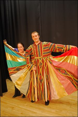 From left, Jaime Becker at the Narrator and Andy Dysard as Joseph in Waterville Playshop's production of 'Joseph and the Amazing Technicolor Dreamcoat.'