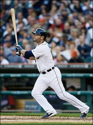 Detroit Tigers Alex Avila watches as his solo home run clears the fence during the second inning against the Minnesota Twins in Detroit.