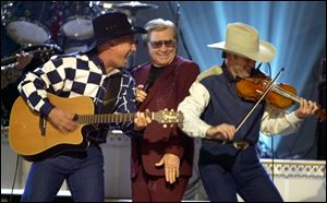 George Jones' (center) vast catalog — he famously scored chart hits in five different decades — provided plenty of entry points for young fans to discover him without the baggage of country-music trend cycles.