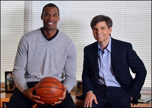 NBA basketball veteran Jason Collins, left, poses for a photo with ABC television journalist George Stephanopoulos. Collins participated in an exclusive interview with Stephanopoulos for Good Morning America.