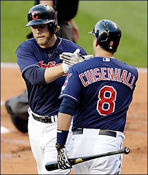 The Indians' Mark Reynolds, left, is congratulated by Lonnie Chisenhall after he hit a homer.