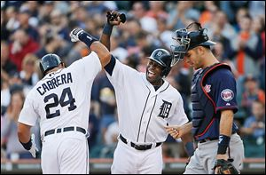 Detroit Tigers' Miguel Cabrera celebrates his two-run home run by teammate Torii Hunter.
