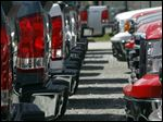 In this Thursday, April 25, 2013, photo, GMC trucks are lined up on the lot of Capitol City Buick Pontiac GMC in Montpelier, Vt. The auto industry is expected to post its best April sales totals since 2007 when major automakers report monthly tallies Wednesday, May 1, 2013. (AP Photo/Toby Talbot)