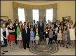 Former President George W. Bush, center, poses with 43 students from Dallas-Fort Worth Schools who were the first 43 official guest to tour the Bush Presidential Library on its' opening day in Dallas.