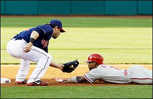 Cleveland's Jason Kipnis tags out Philadelphia's Jimmy Rollins at second base. The Indians have won four consecutive games.