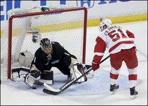 Anaheim Ducks goalie Jonas Hiller blocks a shot by Detroit Red Wings center Valtteri Filppula during the first period.
