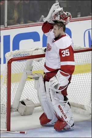 Detroit Red Wings goalie Jimmy Howard reacts after getting kicked in the head by Anaheim Ducks right wing Corey Perry during the second period.