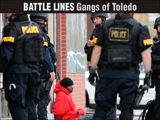 Battle Lines: Gangs of Toledo Cincinnati police detain a suspect after targeting members of the Walnut Hills Posse in 2011. Gang-related homicides dropped 42 percent after the effort.