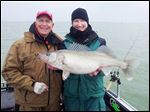 Lake Erie guide Ross Robertson, right, and angler Bruce Samson of Minnetrista, Minn., with a monster spring walleye they caught in April west of the Bass Islands in Lake Erie. The fish measured 29 inches long and weighed 10 pounds.