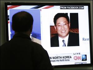 A South Korean man watches a television news program showing Korean American Kenneth Bae at the Seoul Railway Station in Seoul, South Korea.