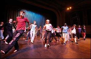 Students from the Toledo School for the Arts rehearse at the Ohio Theatre, from front left, Henry Tylinski, 13, Chloe Hudson, 13, and Khalil Carpenter, 12.