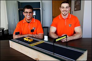 Bowling Green University engineering technology seniors Kevin Baumann, left, and Seth Cooper designed a system aimed to prevent wrong-way crashes. The effort was part of a 'capstone' senior project. They said they hoped a master's student would take over the project.