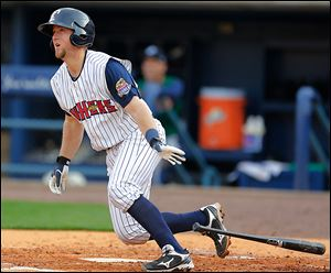 The Mud Hens' Bryan Holaday hits a double to drive in a run against the Charlotte Knights in the second inning at Fifth Third Field. Holaday had three hits.