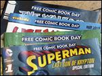 Displayed are comics set asside for Free Comic Book Day at Brave New Worlds in Philadelphia.