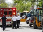 Toledo police and fire crews and Columbia Gas workers confer at the scene of a gas flare-up in the 800 block of Utah Street.