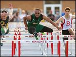 Start High School's Dionte Carey, center, outraces Clay's Jack Nagy, left, and Bedford's Trent Santiago to win the 110 meter hurdles during the Knight Relays at St. Francis. Findlay won the team title. STORY ON PAGE 3.