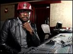 will.i.am poses for a portrait in Los Angeles. The Black Eyed Peas frontman is computer chip-maker Intel's director of creative innovation. He's also partnered with Coca-Cola to create a new brand of products from recycled bottles and cans, including headphones and clothes.