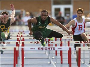 Start High School's Dionte Carey, center, out races Oregon Clay's Jack Nagy, left, and Bedford's Trent Santiago, right, to win the 110 meter hurdles.
